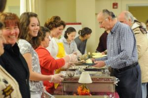 November 25, 2010 - Northampton - Staff photo by Michael S. Gordon - Volunteers serve guests at the annual Thanksgiving Day Manna Soup Kitchen, Inc. dinner at the Edwards Church Thursday.